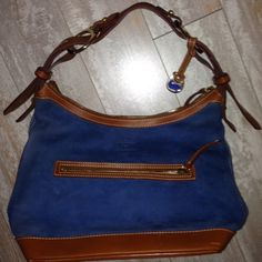 Dooney Bourke Stretch Slouch Suede Denim Honey Dooney Bourke Medium Stretch Slouch Suede Denim Honey   PReOwned   10.5 L x 6W x 10H   No dust storage bag Has some scuffing on leather pipping noticeable  Has some scuffing on suede Liner excellent Zipper smooth Dooney & Bourke Bags Hobos