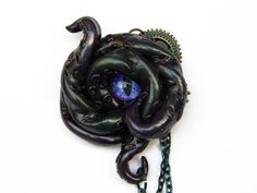 SALE - Eye of Cthulhu Kraken tentacle and eye brooch in deep green and purple with pearlescent finish - Polymer clay with violet + blue eye