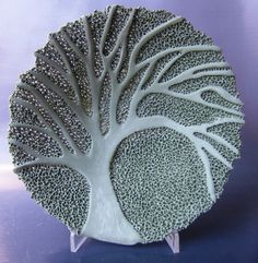 Put a paper pattern over the design and texture the surrounding areas. Rika Herbst Ceramics