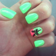 Bright green nails with a palm tree