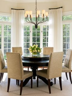 dining room... i like the windows and idea of the table/chairs in the center