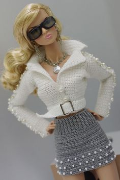 crochet fashion doll dress and coatBarbie Doll Crochet Clothes (Barbies Fashion) to BRL 25 in PriceLandia BrazilExquisitely crocheted outfit for Barbie.www lojaabril com br manequim moldes onlineMe as a Barbie . Crochet Doll Dress, Crochet Barbie Clothes, Doll Clothes Barbie, Barbie Dress, Barbie Outfits, Crochet Skirts, Knitted Dolls, Barbie Knitting Patterns, Barbie Clothes Patterns