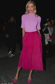 Model behavior! Karlie Kloss radiated retro elegance in a tight orchid-colored sweater and suede pink skirt during was Carolina Herrera's NYFW show Monday