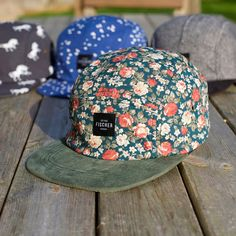 Fischer 1929 floral print 5 panel cap with suede peak. One size with adjustable strap with brass closure. Designed and crafted by us for you.