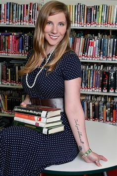 "Tattooed librarians of the Ocean State fundraiser calendar. Love. ""The calendar's cover features an understated but clever tattoo: a finger raised to lips in a 'hush' position. Down the finger are inked the letters 'SHH.'"""