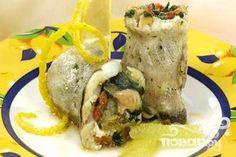 Классический рецепт рыба по-гречески - приготовление традиционного греческого рыбного блюда с лимоном и зеленью. Чаще всего блюдо подается к семейному праздничному столу.