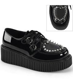 Demonia Black Two Inch Platform Creeper Featuring See-Through Heart Cutout Design, D-Ring Lace, Pointed Studs and Piping Detail. Available in whole sizes only. If your in between sizes we suggest to o