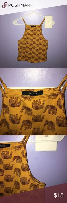 Elephant high neck crop top Above the belly button, comfortable and really cute with bralettes. Tops Crop Tops