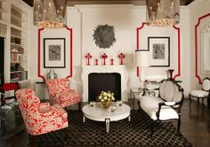 3. Black and white design with red trim detail along the walls. Patterns and geometric shape on the carpet. The style of the sofas, that's usually found in her designs. Low coffee table, and reflective lights hanging down. Not overly done, a simple and sleek design. If you look a lot of designs for hollywood regency has upholsters seats.