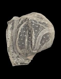 Woman's embroidered net cap. American, early 19th century. Linen net with cotton embroidery and trim. Via Museum of Fine Arts Boston costume collection.