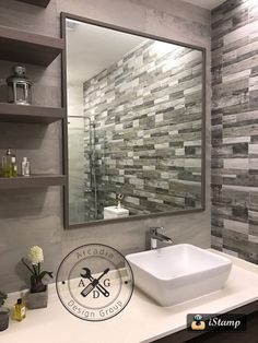 Master bathroom with Stone Italiana Rocface counterop, Grohe faucet, Johnson Suisse sink and custom made vanity #tiles #grohe #johnson_suisse #bathroom #hafary #stone_italiana #carpentry #vanity #design #decor #interiordesign #id #renovations #singapore #homeanddecorsg