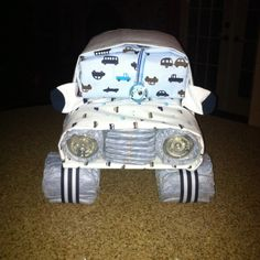 Diaper Cake DIY Instructions   momaroo - saw something similar to this using disposable diapers and onesies and other small articles of clothing or washcloths. Description from pinterest.com. I searched for this on bing.com/images