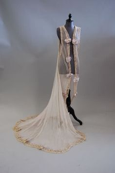 Jacques Doucet déshabillé (negligee) of pale lavender chiffon edged with needlerun lace, ruched ribbons, and large satin rosettes; circa 1905-1910