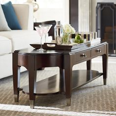 The clean sophisticated lines of the Cosmopolitan Long Cocktail Table by Bassett Furniture give an updated look and feel.