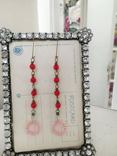 nandinaupcycled red beaded wire wrapped dangle earrings by Arey