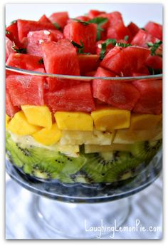 Rainbow Fruit Salad with Lemon Balm Syrup & Coconut Whipped Cream...this would be fun in smaller cup sizes