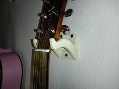 """Featured as thing of the week in http://threedprintingtoday.libsyn.com/webpage/category/Podcast podcast #57 Thanks Andy and Whitney!! :-)     Super smart guitar wall mount with guitar pick shelf. This fits most of STD neck guitars. I have tested it on acoustic 6 string, acoustic 6 string medium size(for young adults), acoustic 12 string, electric bass and electric 6 string guitars and worked like magic on all of them. And it certainly fits my """"AMGP (Adapto Modular Guitar Pro) 3D Printable…"""