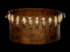 This Inupiaq feast bowl was collected in 1934 in Wales, Alaska. The ivory carvings on this bowl represent adult bowhead whales, a beluga whale and other animals. Blue beads on the whale figures mark the location of the animal's life force and the place where the harpooner aims. Image: National Museum of the American Indian Photo Services