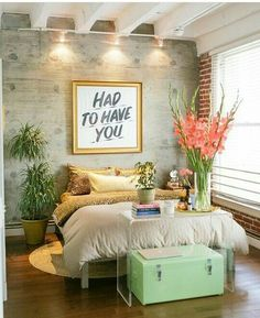 love the plants and the art over the bed