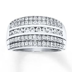 This magnificent anniversary ring for her features rows of dazzling diamonds totaling 1 carat. The ring is styled in beautiful 14K white gold. Diamond Total Carat Weight may range from .95 - 1.11 carats.