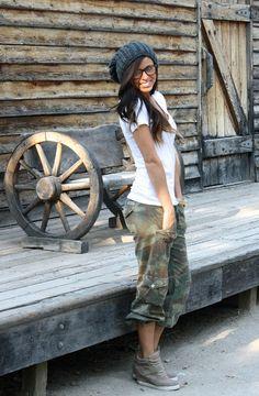 white tshirt, baggy camo capris, light gray tennis shoe pump wedges, wool beanie, and nerd glasses.