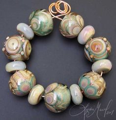 Google Image Result for http://images.fineartamerica.com/images-medium/her-grace-lampwork-bead-set-lydia-muell.jpg