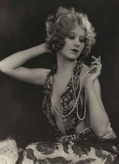 Faith Bacon ~ 1930's. How nice to know that pearls can be a girls best friend (too).
