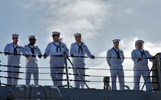 Sailors, assigned to the guided-missile destroyer USS Chung-Hoon (DDG 93), stand ready for the ship's departure from Joint Base Pearl Harbor-Hickam for an independent deployment to the Indo-Asia-Pacific region. The ship and its crew will conduct integrated operations in conjunction with allies and partners. (U.S. Navy photo by Mass Communication Specialist 3rd Class Diana Quinlan/Released)