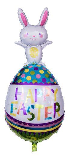 """Der Heliumballon stellt ein überdimensionales Osterei mit einem darauf stehenden weißen Hasen mit ausgestreckten Armen dar. Das Osterei ist farbenfroh gestaltet und hat """"Happy Easter"""" in bunten Buchstaben darauf abgedruckt."""
