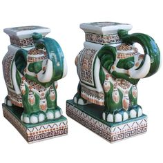 Pair large Ceramic Elephant stools    20th Century  Pair of ceramic Elephant stools- great for the any room or garden. Trunks up for good luck!