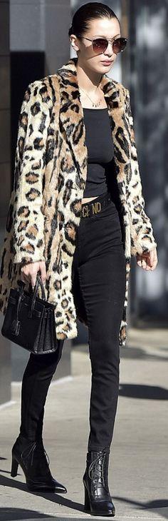 Bella Hadid in Coat – House of Harlow 1960 x Revolve  Necklace – Them Jewelers x Danielle Guizio  Shoes – Stuart Weitzman  Belt – Moschino  Sunglasses – Quay  Purse – Saint Laurent