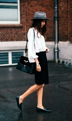 Long sleeved white blouse with black pencil skirt and flats or loafers.