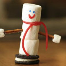 """Edible Snowman Table-Top Decorations. """"These are so cute...and easy. They would make a cute snack for my Sunday school class!"""""""