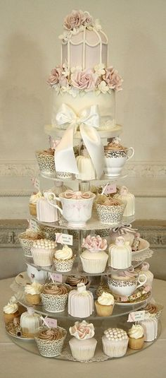 We are absolutely head over heels for this breathtaking cupcake display! #weddingideas