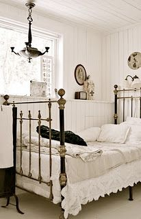lovely antique linens, bed and chandelier in this vintage Swedish bedroom
