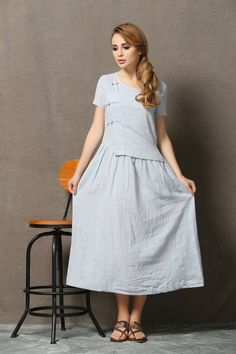 This light blue linen dress celebrates all body types day or night. Its a lightweight fabric that will hug your curves without clinging for a super flattering look. The round neckline will show off your collarbone for an extra feminine touch. Theres no doubt that this dress will soon become a staple piece in your wardrobe. Its versatility has no bounds! Youll wear it to work, to lunch with the girls and out to do your shopping. For each occasion you can choose different accessories and youll…