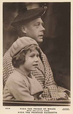A young Queen Elizabeth with her father, King George VI. Wrong, King Edward the VII.  Her dad's brother.