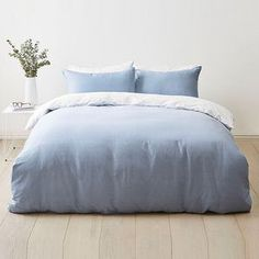 Breathe new life into your bedroom decor with our beautiful Blue Ombre Quilt Cover set. It's finished with a clean and simple detail that emits a still...