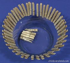 Purchased a plastic bowl at Wal-Mart and a fifty count bag of clothespins. Put the clothespins in the bowl and had the children put the clothespins around the rim of the bowl.  Extensions-have children put clothespins in number order or ABC order.