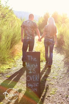 This is cute, having the couple walk away from the sign like this!