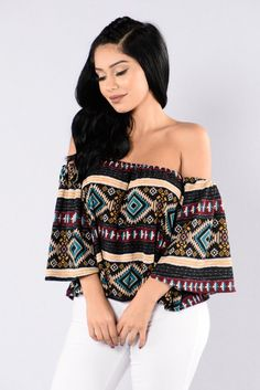 - Available in Multi - Tribal Print - Off The Shoulder - Cropped - 3/4 Bell Sleeve - 96% Rayon, 4% Spandex