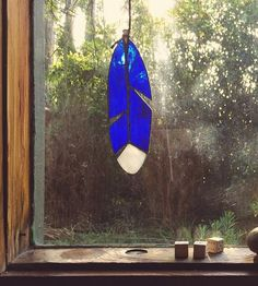 Each bird feather comes looped on a leather cord, ready to hang from rearview mirrors, to catch light in a window or to display in the garden next to the birdbath.