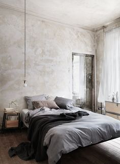 bedroom: raw wall, grey bedlinen | Photo Petra Bindel, Styling Emma Persson Lagerberg for Åhléns