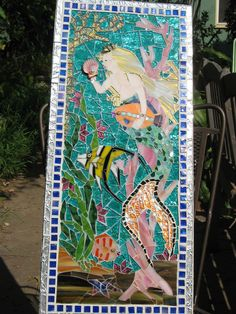18 inches X 30 inches on board. I used glass, mirror,milifiore, shell, pearl, beads, broken jewelry, dichroic glass, glass tiles, foil. She has been sold