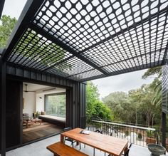 Raising up from the backyard of this house is an outdoor dining area located just off the living room.
