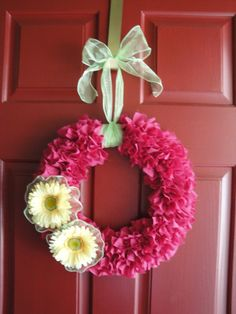 hot pink wreath, yellow flowers, and lime green ribbon...perfect for spring and summer (or a girl's bedroom)