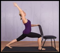 A modified version of the cresent lunge yoga pose using a chair.