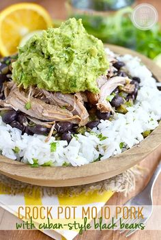 Crock Pot Mojo Pork with Cuban-Style Black Beans is a simple and satisfying long-cooking crock pot recipe. Use to make tacos, nachos, or rice bowls! | iowagirleats.com