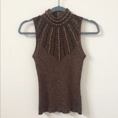 "✨REDUCED ✨Cache Beaded Silk Sleeveless Turtleneck Beautiful top, great for the holidays! Intricate beading with gold metallic woven throughout giving it a bronze appearance. Ribbed sweater stretchable silk blend; 58% silk 25% cotton 17% metallic. 3 snap button closure at back keyhole. Hand washable. Waist 24"" Bust 28"" Full Length 23"" Length from underarm 13"". Measurements when lying flat but has a lot of stretch. Excellent condition! Offers welcome! Cache Tops"