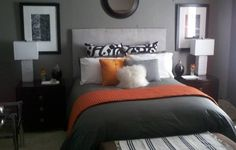 I wanted to create a modern, calm, yet cheerful sleeping retreat. Using charcoal gray & white with orange accents was the perfect choice for me. For Christmas, I replaced the orange with burgundy, but couldn't wait to bring the orange back.